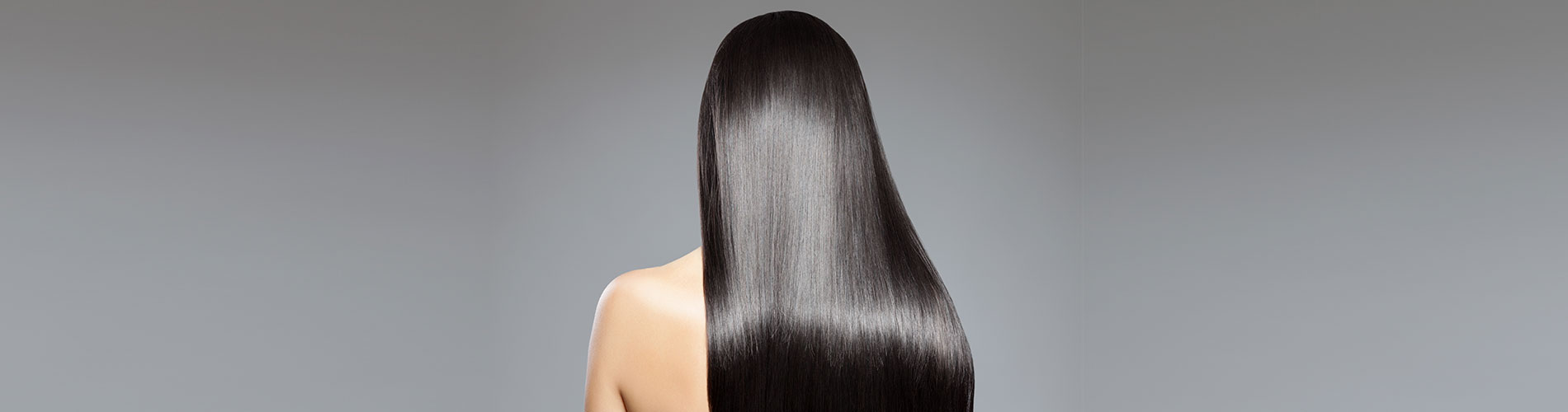 lady with long black healthy smooth hair and on grey background
