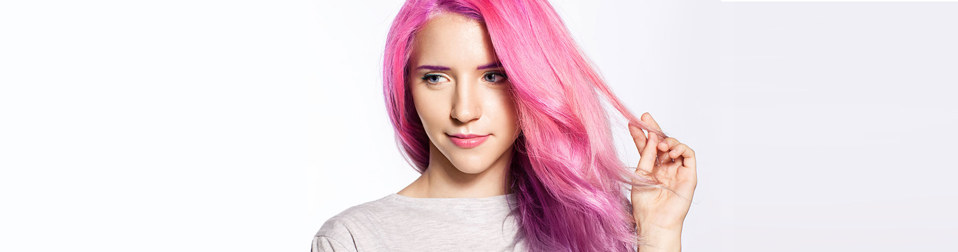 young lady with bright pink hair on white background